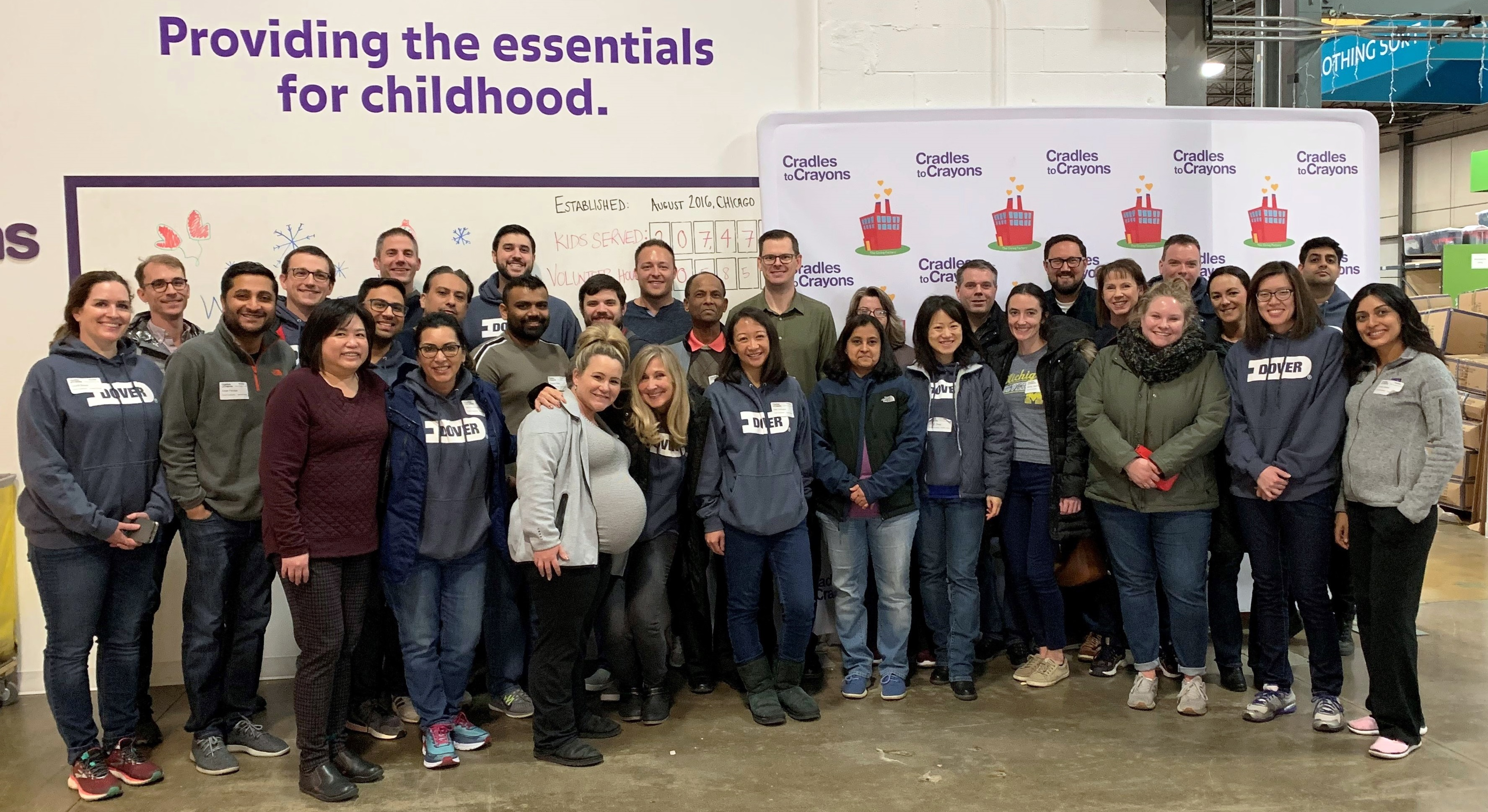 Dover Team Members Volunteer at Cradles to Crayons