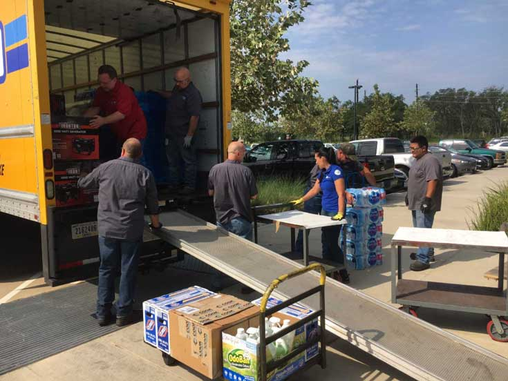 Dover team members unloading supplies for Hurricane Harvey victims
