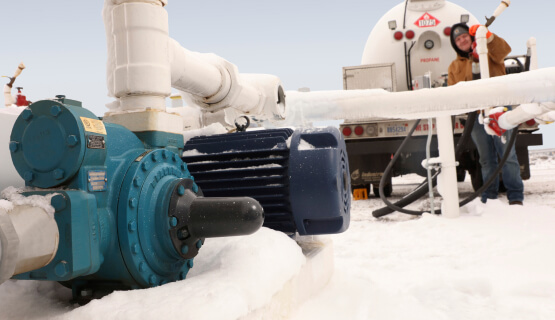 Man working pump in arctic conditions
