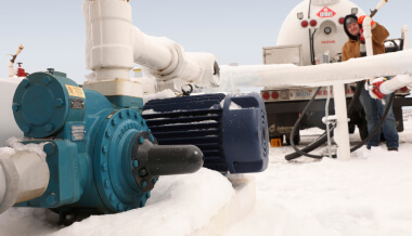 Man working with pumps in arctic environment