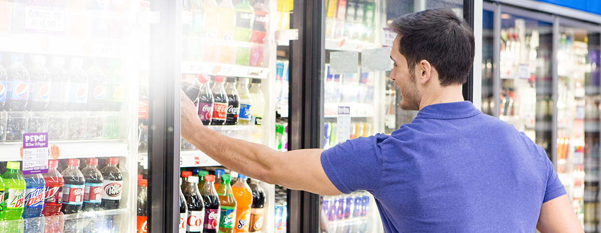Man selecting beverage from case